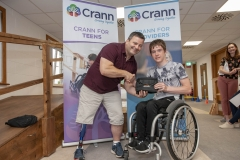 Cian Horgan holds his repair kit with course creator Paul Ryan from the IWA Sport.