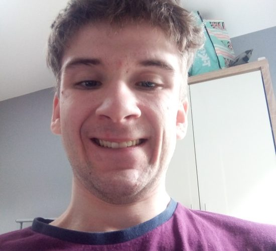 Portrait Picture of Callum, a young man smiling.