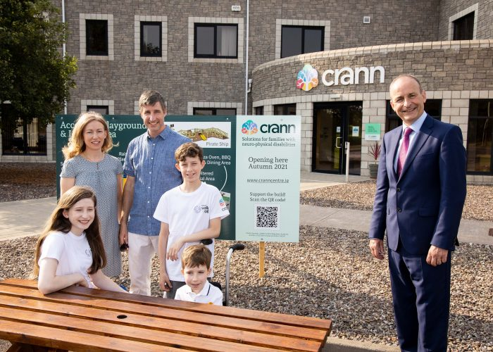 Brendan and his family pictured with An Taoiseach Micheál Martin outside the Crann Building