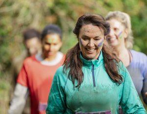 Woman in green doing a charity run.