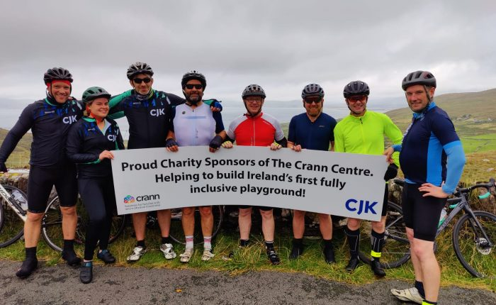 The CJK team after their challenge with a banner with Crann and CJK logos